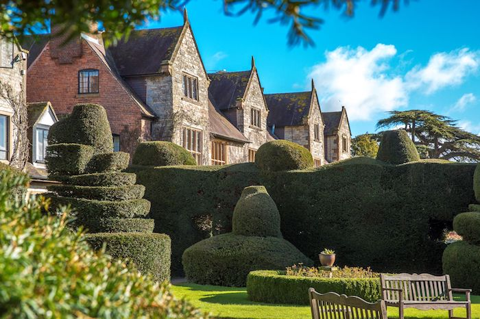 Exterior image of Billesley Manor Hotel, surrounded by manicured gardens.