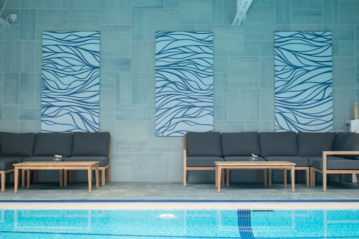 Hotel pool surrounded by comfortable seating. Relaxing and hydrating for the skin.