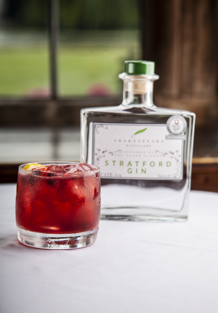 Berry cocktail sat beside a bottle of Stratford Gin.