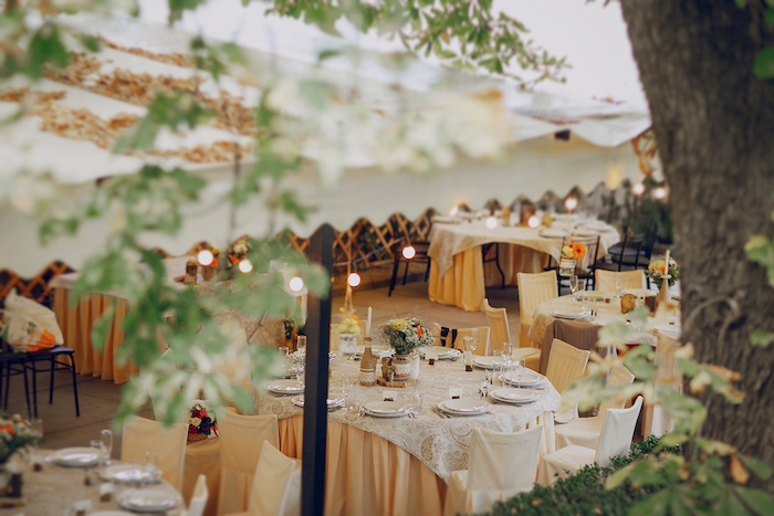 Outdoor wedding shelter - dining set-up inside a tent.