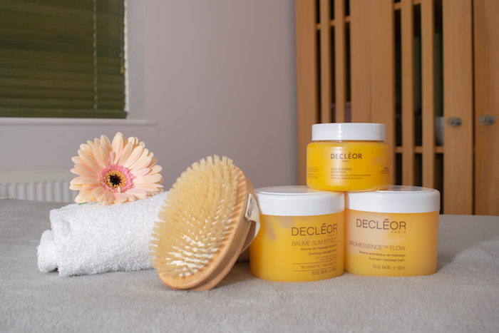 Pile of Deceor products on a treatment bed at Billesley Manor spa.